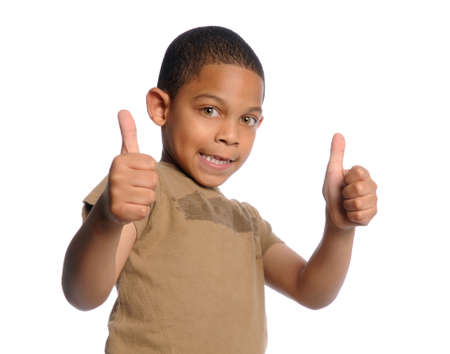 adolescent african american: Young African american boy giving the thumbs up