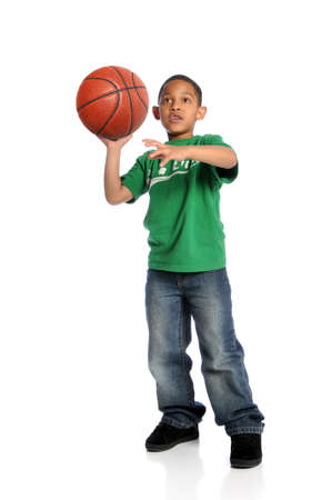 Young African American boy playing basketball isolated over white background photo