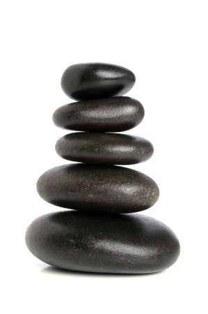 stack stones: Fives black stones stacked upon each other isolated over white background