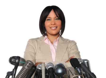 public speaking: African American woman in front of microphones isolated over white Stock Photo