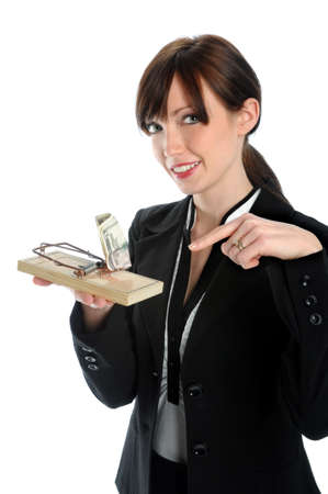 Businesswoman holding mouse trap with bait money photo