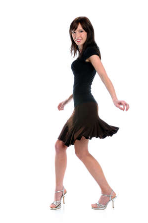Young woman with skirt and high heels dancing Reklamní fotografie