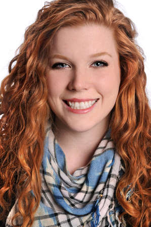 red head woman: Portrait of young red head woman smiling isolated over white background