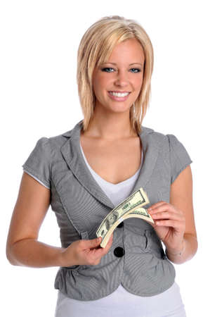 Beautiful young businesswoman holding a bundle of money isolated over white background photo