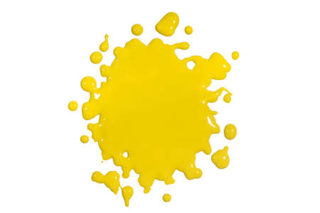 Yellow paint splatter isolated over white background photo