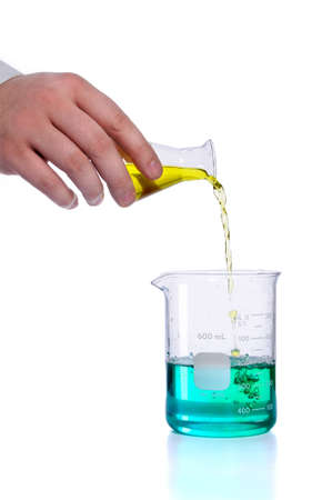 Hand pouring liquid into flak over white background Stock Photo - 7972899