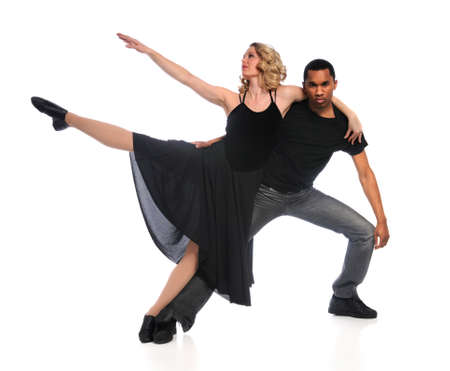 Couple performing dance isolated over white background photo