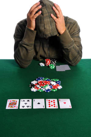 Poker player holding head in despair