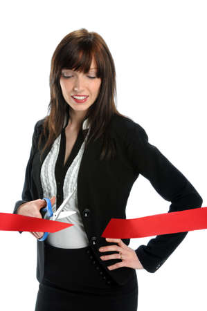 Businesswoman cutting red ribbon isolated over white background photo