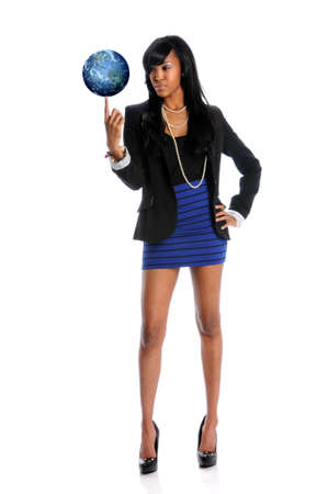 fingertip: Young African american businesswoman balancing the world on fingertip