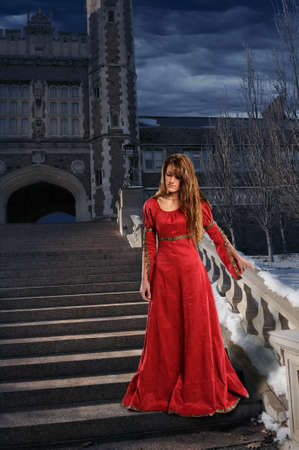 medieval dress: Beautiful young woman on steps dressed in Renaissance clothing  Stock Photo