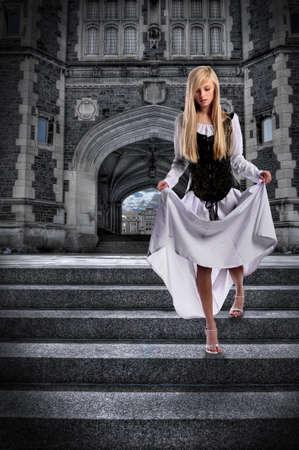 descending: Beautiful young woman descending steps of castle