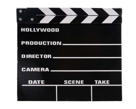 Vintage clapper board isolated over white background photo