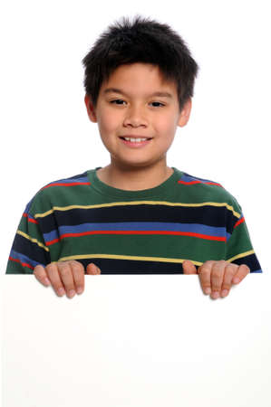 Boy holding blank sign isolated over white background photo