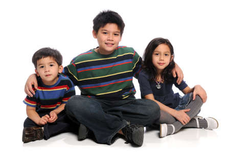 sister: Three siblings sitting together over white background