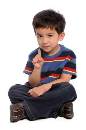 Jongen gesturing nummer een geïsoleerd op witte achtergrond Stockfoto