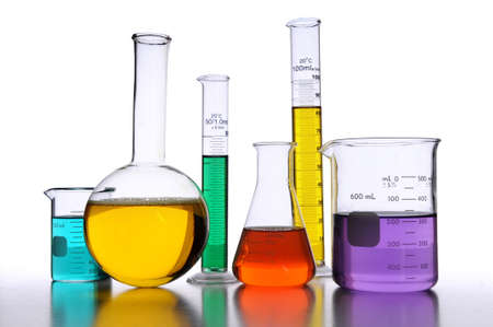 Laboratory glassware with liquids of different colors over white background Stock Photo - 8025265