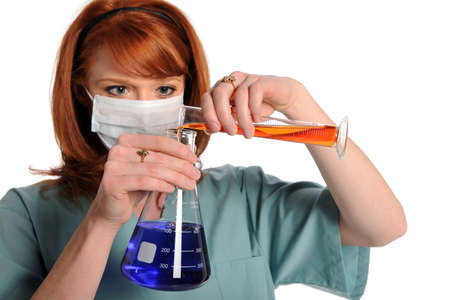 Lab technician mexing chemicals Stock Photo - 15075039