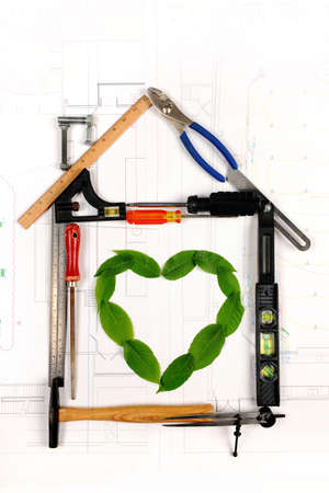 responsibly: House made of tools with heart formed by leaves in the middle