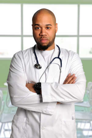 African American doctor with arms crossed photo