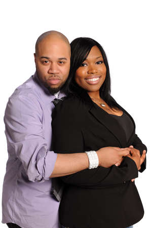Young African american couple embracing isolated over white background