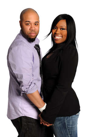 couple afro americain: Couple de jeunes afro-am�ricains main dans la main, isol� sur fond blanc Banque d'images