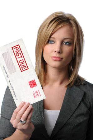 Beautiful young woman holding Past Due envelope isolated over white photo