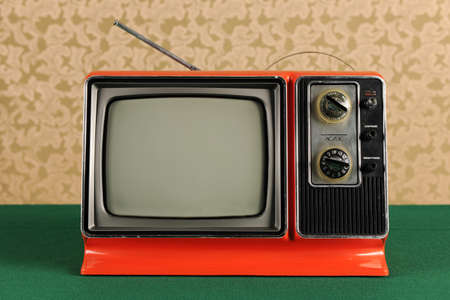 retro tv: Orange vintage television in 1970s environment