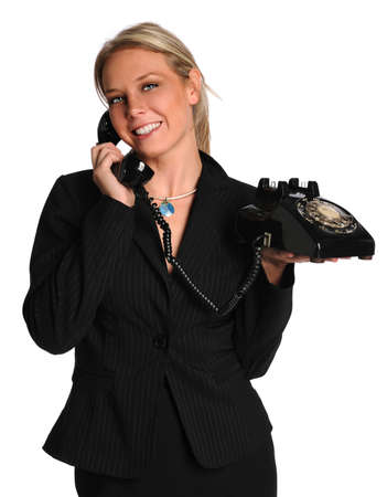 Beautiful businesswoman using vintage phone isolated over white background Stock Photo - 8110810