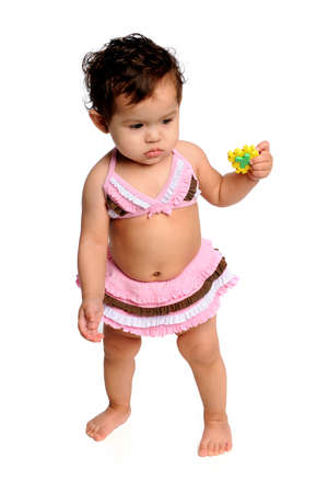 Hispanic young girl dressed in bathing suit standing