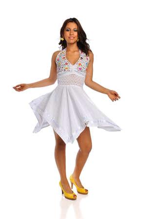 Portrait of beautiful Latino woman in white dress photo