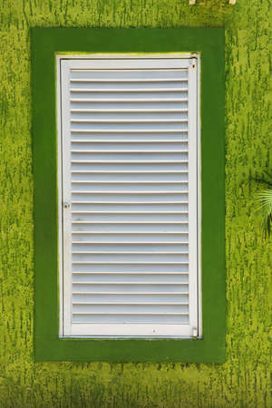 cozumel: Window over bright green textured wall in Cozumel Mexico