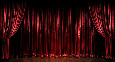 red stage curtain: Stage red curtains over wooden floor