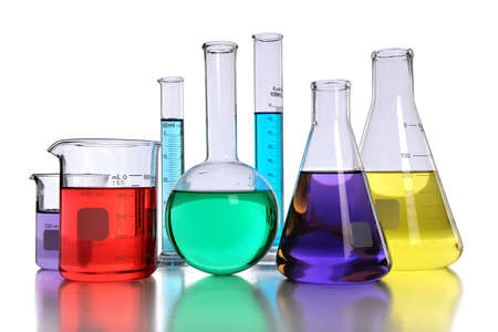 Laboratory glassware with various colored liquids with reflection on table Stock Photo - 8129975