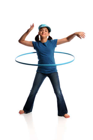 hoops: Young girl playing with hula hoop isolated over white background