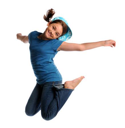 Ritratto di giovane ragazza saltando isolato su sfondo bianco Archivio Fotografico - 8130628