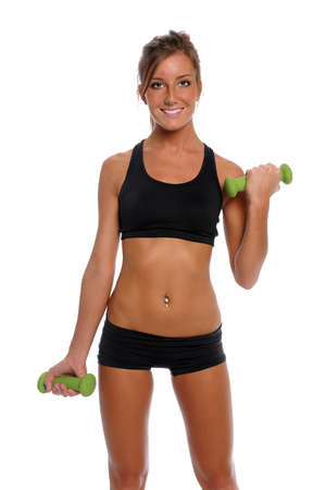 Young woman exercising with dumbbells isolated over white background photo
