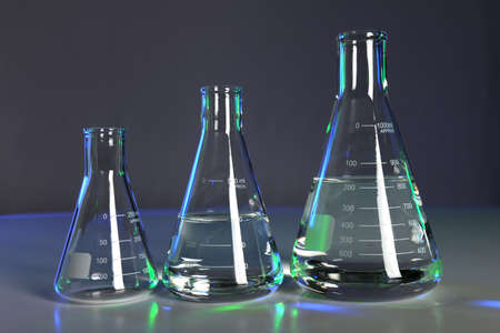 Flasks with fluid in laboratory setting