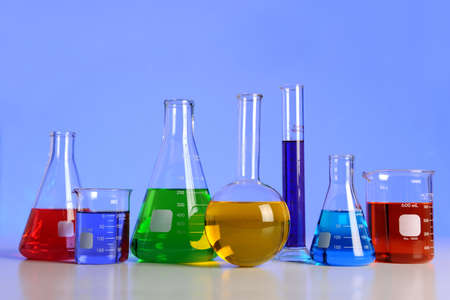 Laboratory glassware over blue background with reflections on table Stock Photo - 8204838