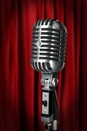 old microphone: Vintage microphone with red curtain in background