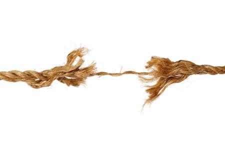 breaking: Frayed rope isolated over white background