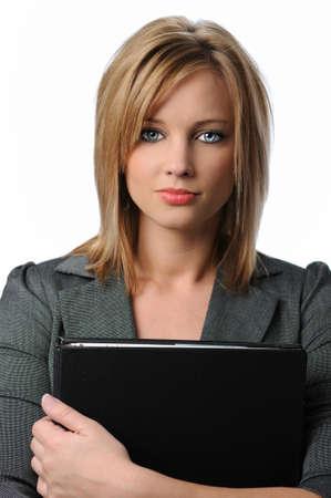 Portrait of beautiful businesswoman holding folder photo