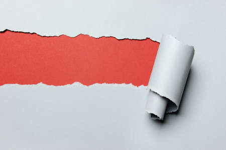 torn: Gray Torn paper with red background in opening