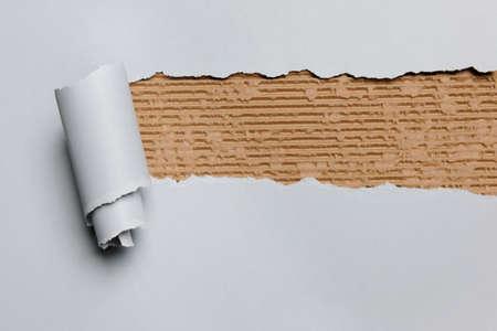 rip: Gray ripped paper revealing cardboard