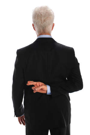 people from behind: Mature businessman with fingers crossed behind back isolated over white background Stock Photo