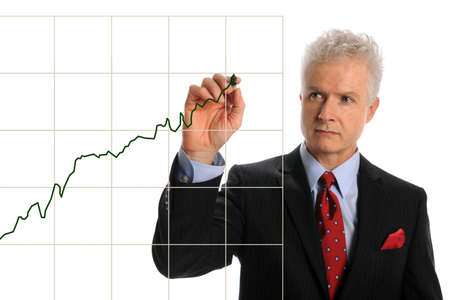 Portrait of mature businessman drawing chart isolated over white background