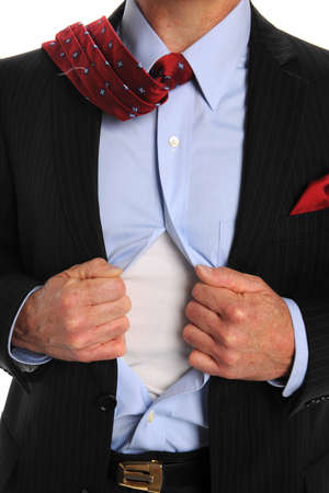 Torso of businessman opening shirt to reveal t-shirt Stock Photo - 8204983