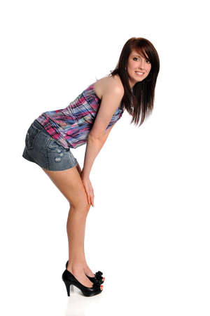 Beautiful teenage girl standing isolated over white background