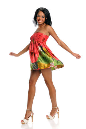 Beautiful African American woman in colorful dress isolated over white background Reklamní fotografie