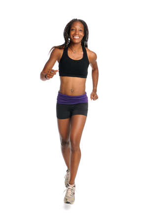 Young African American woman running isolated over white background photo